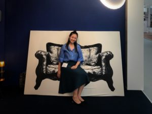 Tania against a backdrop of a chair